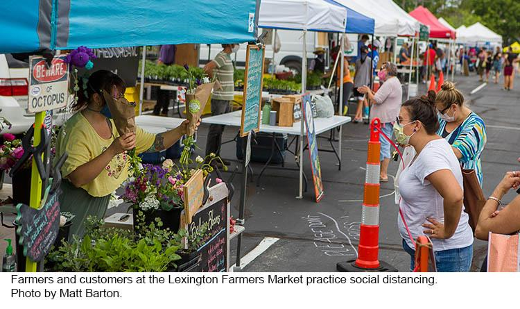 Cutomers practice social distancing at the Lexington Farmers Market.