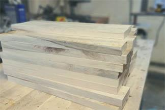 A stack of sweetgum lumber that has been planed and cut