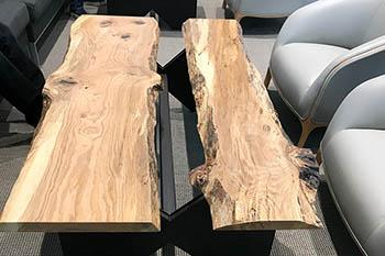 The live-edge tables were manufactured by craftsmen and UK students at the UK Wood Utilization Center in Breathitt County. Photo by Chad Niman