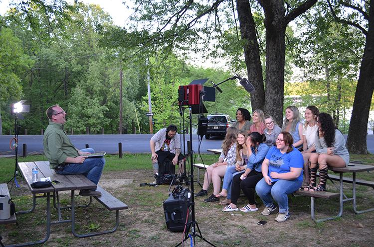 UK associate professor Jason Swanson, left, and UK students recap the day's events on the set of Transformative Travels at Kentucky Dam Village. Photo by Katie Pratt, UK agricultural communications