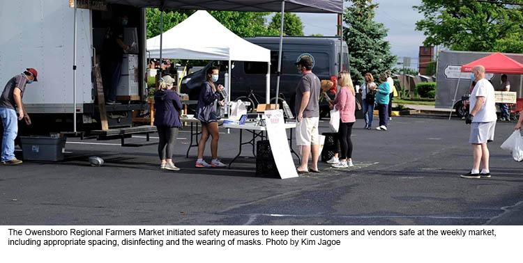 Market day at the Owensboro Regional Farmers Market showing people wearing masks and practicing social distancing