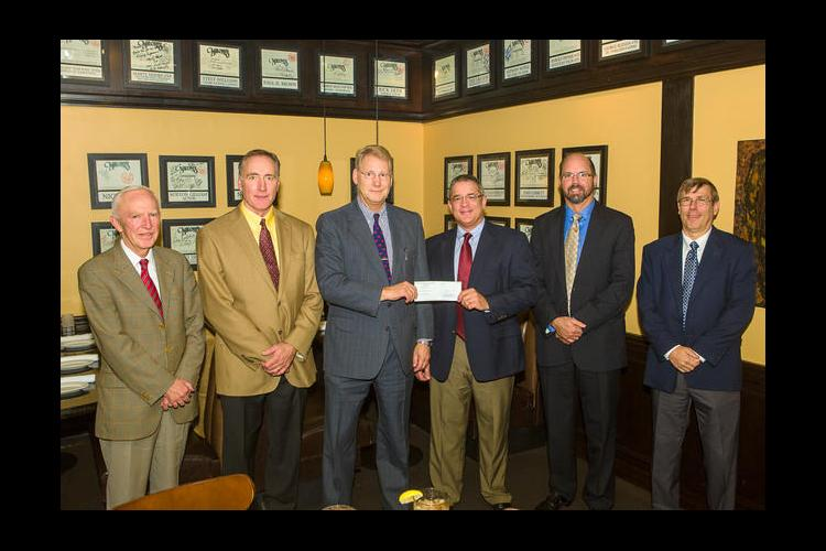 Gluck Equine Research Center Director Dr. Mats Troedsson received a check from Patrick Talley, Lloyd's Regional Director.