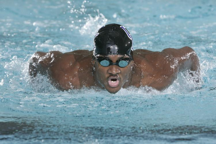 Elvis Burrows Jr., former Olympian and UK swimmer, graduates May 10 with a master's degree in hospitality and dietetic administr