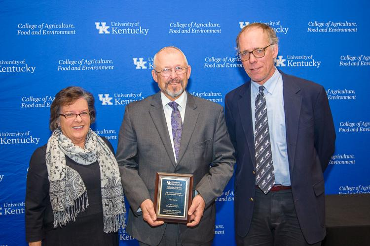 Nancy Cox, UK CAFE dean,  Mick Peterson, right,  director of UK Ag Equine Programs, present the Friend of UK Ag Equine Programs award to Fred Sarver. Photo by Matt Barton, UK agricultural communications.