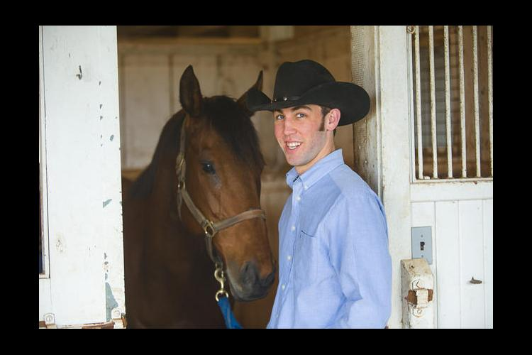 UK student Colton Woods works with horses at UK's Maine Chance Farm.