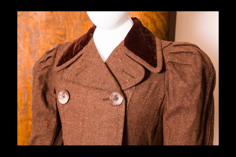 The top of Belle Brezing's brown walking suit. It is on display in UK's Erikson Hall.