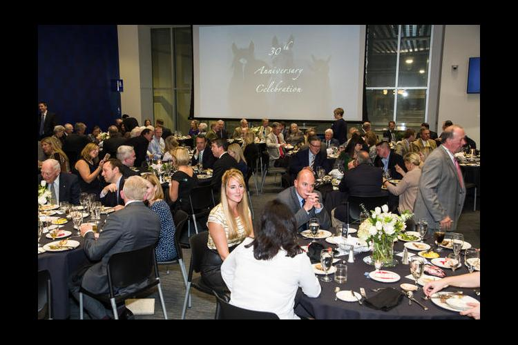 Equine industry representatives attend the UK Gluck Equine Research Center's 30th anniversary celebration dinner.