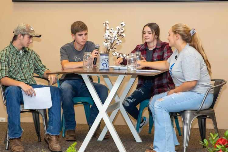 From left: Warren County student Jamison Woosley, Logan County students Colby Collins, Summer Taylor and Warren County student Elivia Heard present a scene in the Farmers' Dinner Theater at the Logan County Extension office. Photo by Steve Patton.