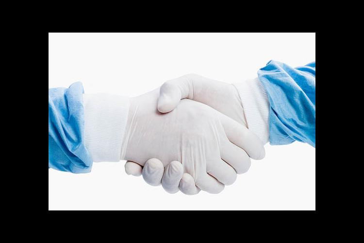 Two latex-gloved hands shaking