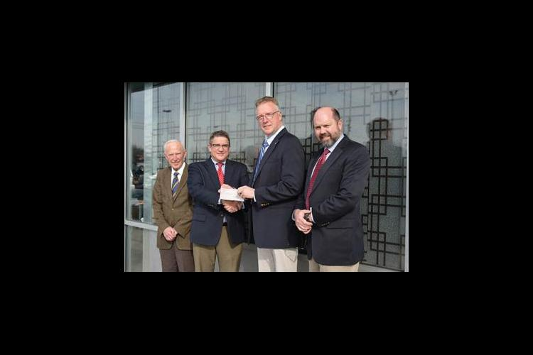 Lloyd's of London recently presented UK representatives with a $50,000 check.