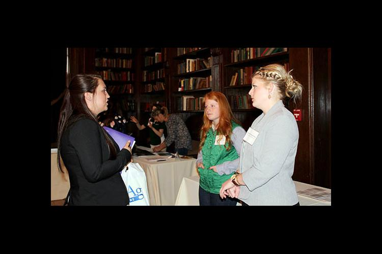 Two UK Ag Equine Program alums give advice to an attendee at the 2017 UK Equine Career and Opportunity Fair.