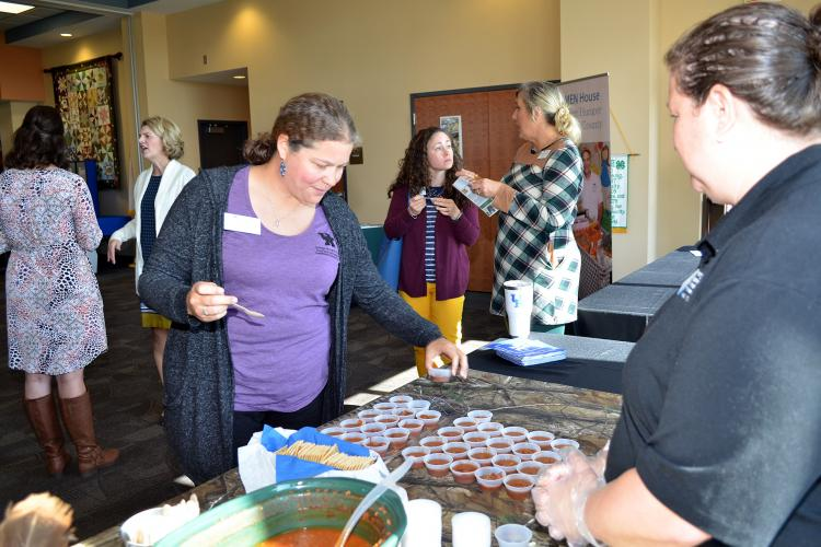 Shonda Johnston, Clark County family and consumer sciences extension agent, tries some venison chili during the recent Cook Wild Kentucky launch party. Photo by Katie Pratt, UK agricultural communications.