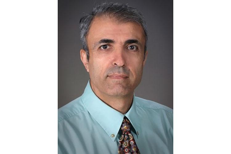 Dr. Erdal Erol received the 2018 BIOMIC Excellence in Diagnostic Veterinary Microbiology Award, photo provided by Dr. Erol.