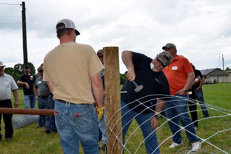 Logan County cattle producer Butch King participates in an on-site fence construction during a 2019 Kentucky Fencing School. Photo by Katie Pratt, UK agricultural communications.