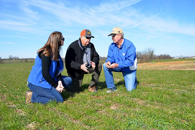 From left, Mattea Mitchell, Hickman County agriculture and natural resources extension agent, Hickman County farmer Jerry Peery and UK soil scientist Lloyd Murdock discuss soil fragipans in a field of annual ryegrass growing on Peery's farm.