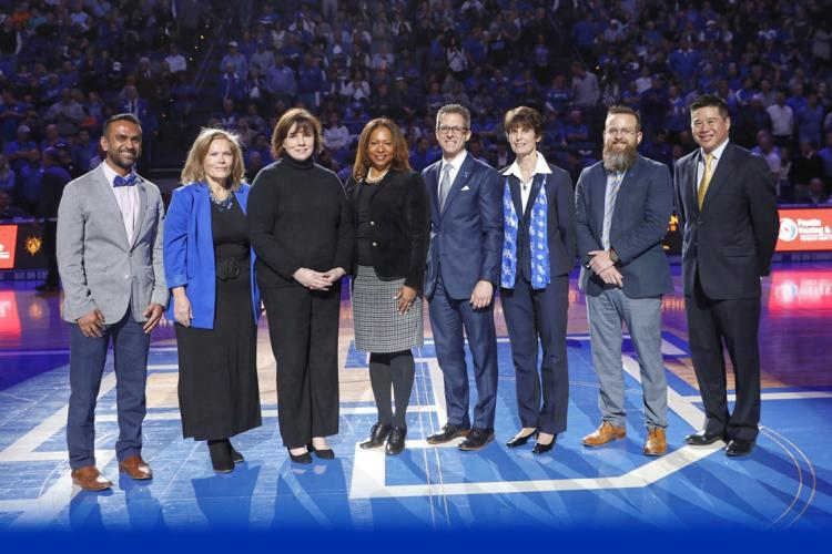 L to R: Darshak Patel, Anna Voskrensensky, Emily Cunningham, Taunya Phillips, David McNear, Martha Riddell, Lou Hirsch, Michael Huang. Phillips and Huang are with the UK Alumni Association. Mark Cornelison | UK Photo.