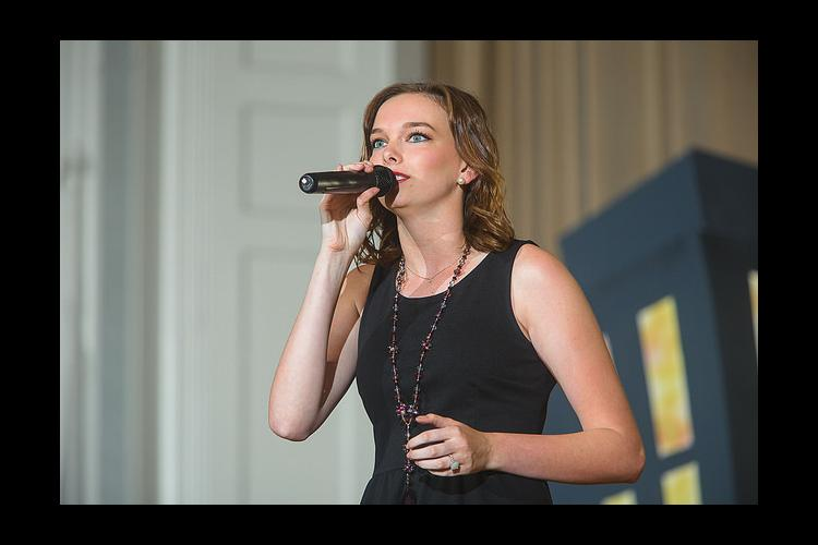 Halie Sawyers sings during a troupe performance.