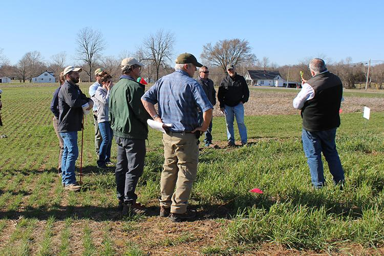 Forage extension specialist Chris Teutsch, right, speaks to participants about forages at a previous UK event. Photo courtesy of KATS.