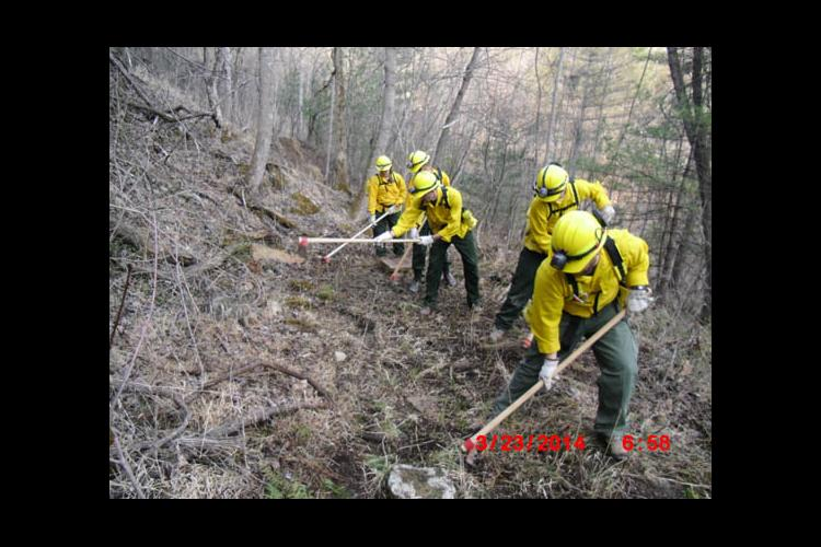 UK Fire Cats constructing a line