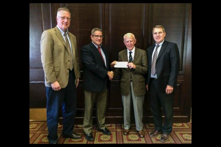 (l-r) David Horohov, Pat Talley, Peter Timoney, Rick Bennett. Talley presents Timoney with check from Lloyd's of London.