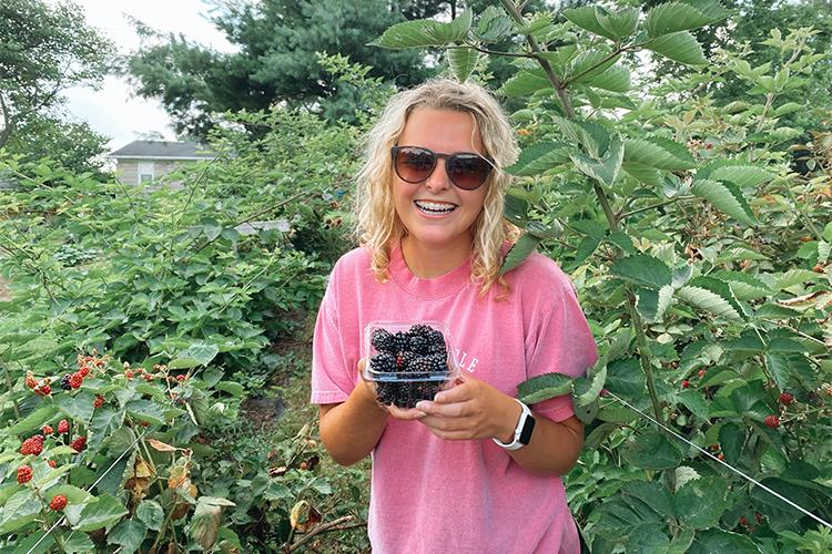 UK student Lucinda Smith, a senior from Corbin, has participated in research and outreach projects that show the health benefits of blackberries to people, who live near Superfund sites. Photo submitted