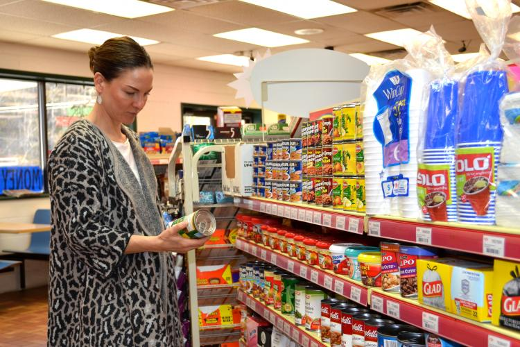 Alison Gustafson, UK associate professor, looks at the nutrition content of items in an Inez convenience store. Photo by Katie Pratt, UK agricultural communications.