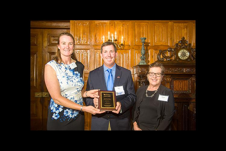 Jill Stowe, left, and Nancy Cox present Matt Koch with the Friend of UK Ag Equine Programs award.
