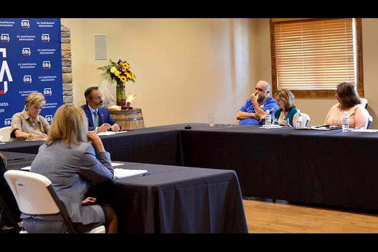 Rhonda Hatfield, owner/founder of Blue Halo Med Spa, speaks to SBA Administrator Linda McMahon and Gov. Matt Bevin during McMahon's recent stop in the state. Photo by: Natalie Cunningham, KSBDC marketing and promotions specialist.