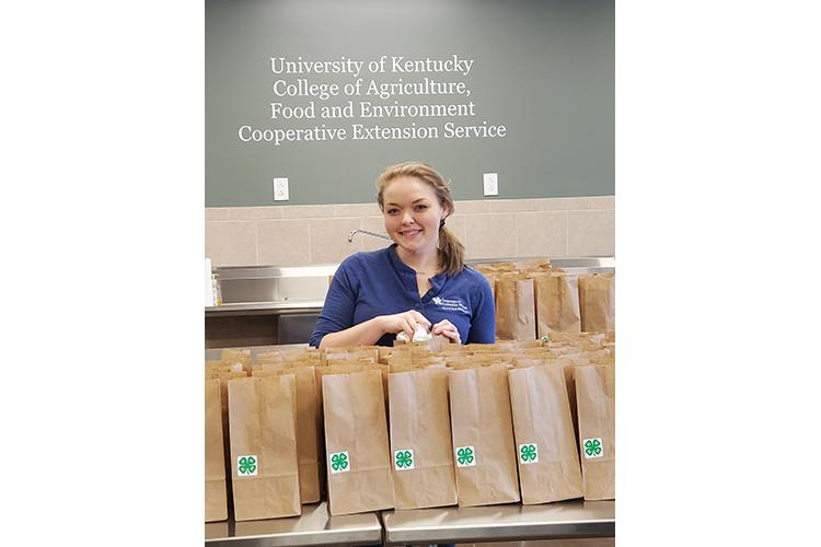 Melissa Schenck, Washington County 4-H youth development agent, prepares Brown Bag Programs in the Washington County Extension office to help families during the pandemic. Photo submitted.