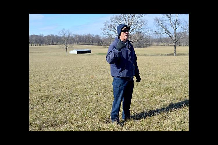 Anderson County producer Mike Wilson talks about his hayfield seeded in novel endophyte tall fescue, which is in the background.