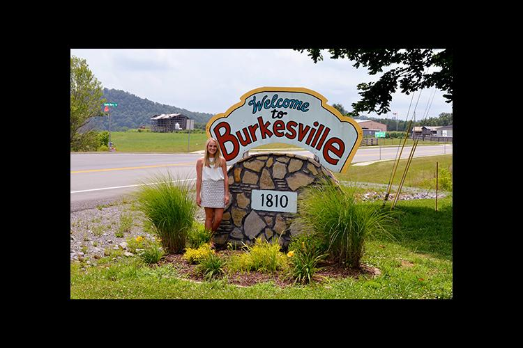 Molly Morgan stands in front of one of the signs she has helped improve.