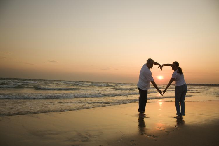 couple on beach with sunset