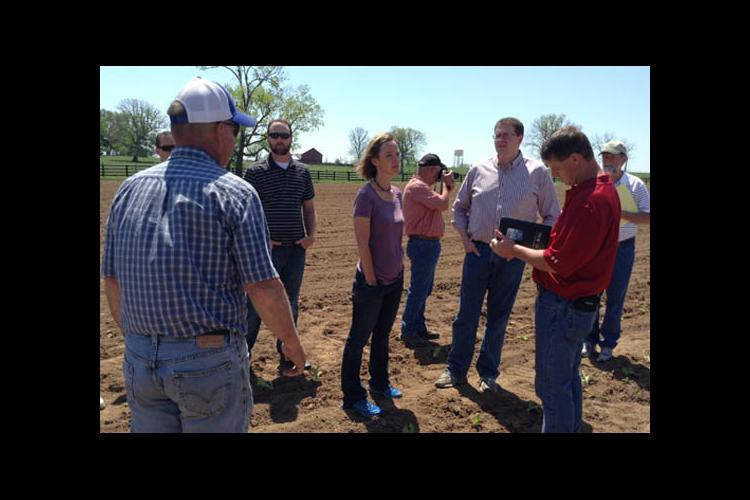 Tom Greathouse speaks with SARE Fellows on his Woodford County Farm.