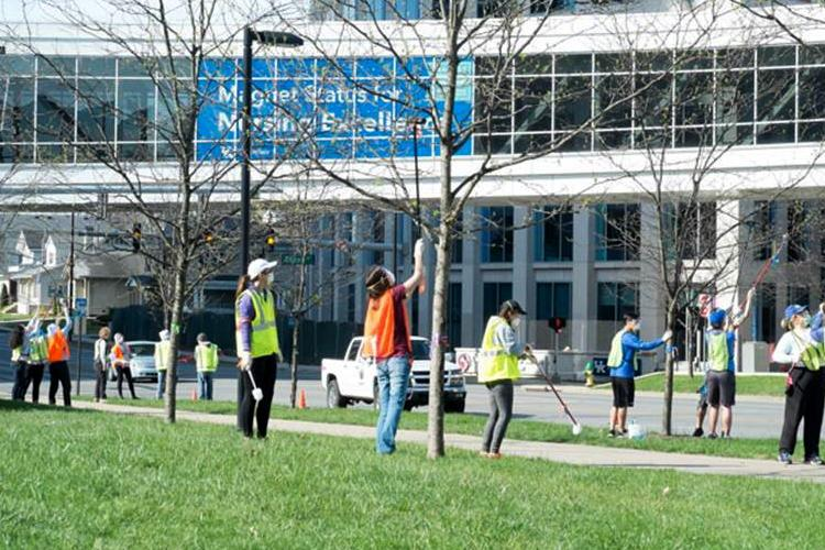 """Student volunteers participated in a """"scale scrub"""" on UK's campus."""