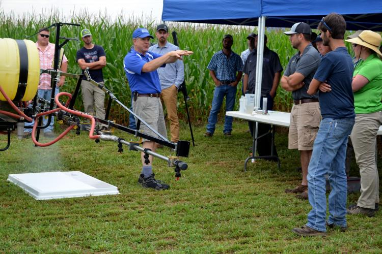 Tim Stombaugh, UK extension professor of biosystems and agricultural engineering, shows participants how to set up and calibrate a sprayer. Photo by Katie Pratt, UK agricultural communications.