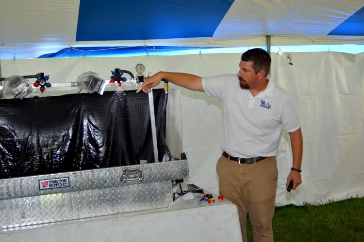 UK weeds scientist Travis Legleiter shows how nozzle design and pressure influences droplet size  at a previous school. Photo by Katie Pratt, UK agricultural communications.