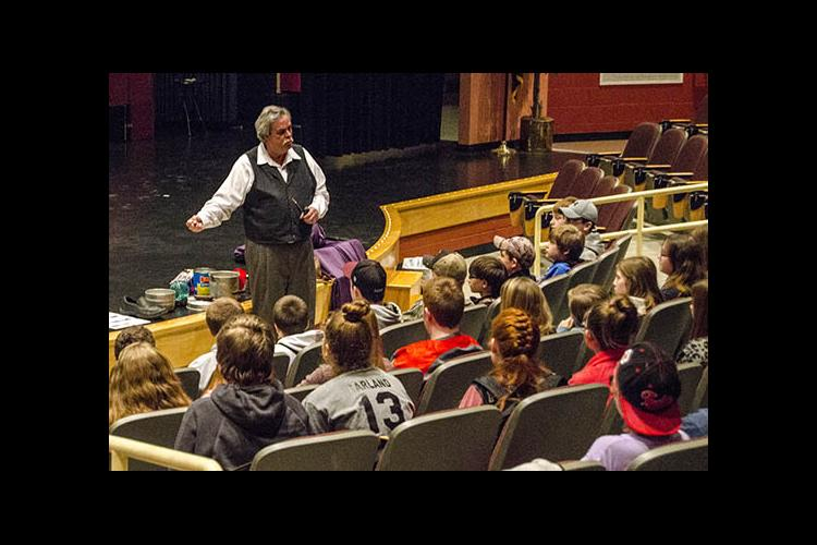 Stephen Hollen weaves his tales for middle-schoolers in Elliott County.