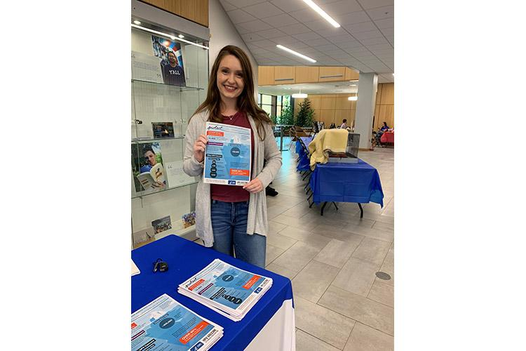 UK student Susanna Goggans works at an outreach event educating people about the HPV vaccine as part of her work with UK Markey Cancer Center's ACTION Program. Photo submitted.