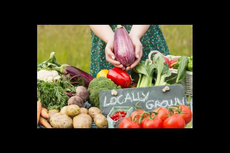 vegetables with locally grown sign