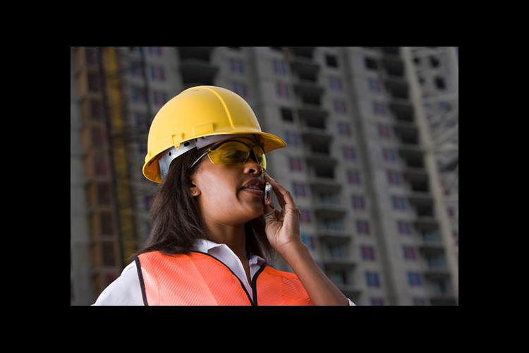 Woman on phone at construction site