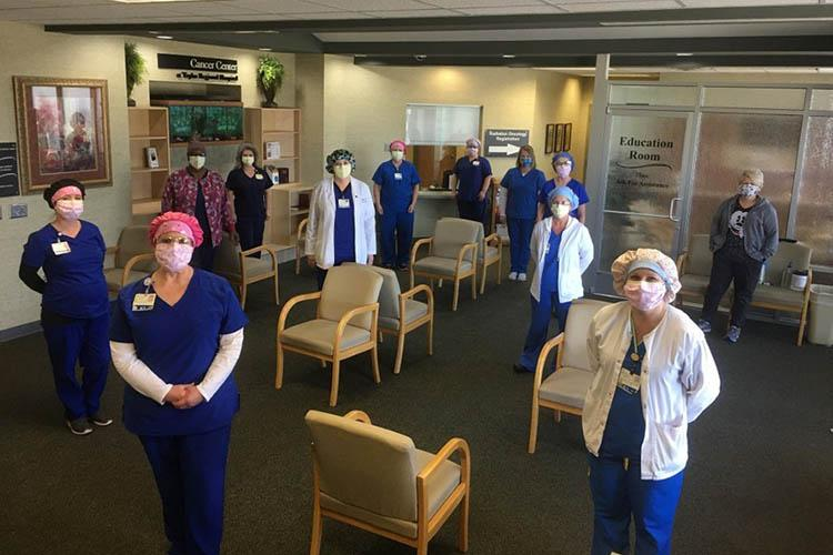 Health care professionals displaying PPE