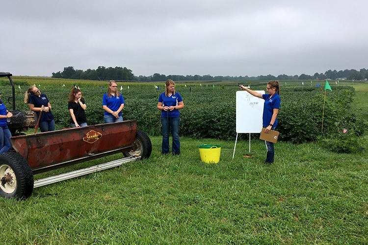 2019 UK intern Hannah York, right, teaches fellow interns from left: McKaylee Copher, Bella Usenza, Gina Merzbacher and Kayla Shelton how to calibrate a Gandy fertilizer spreader. Photo courtesy of Carrie Knott, UKREC director.