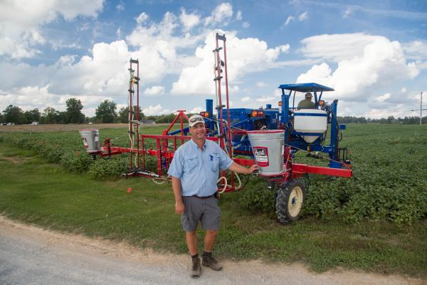 Edwin Ritchey, UK extension soils specialist, gets ready to seed a cover crop mixture into double-crop soybeans earlier this fall at the UK Research and Education Center in Princeton. Photo by Steve Patton, UK agricultural communications.