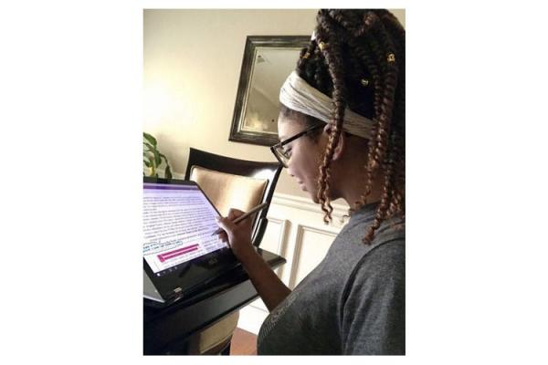 Cheyenne Chandler, UK senior in agricultural and medical biotechnology, analyzes data from her home during her Summer Research Fellowship, following current stay at home ordinances.