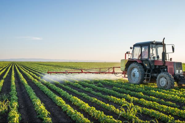 Producer spraying a soybean field. Photo courtesy of Getty Images.