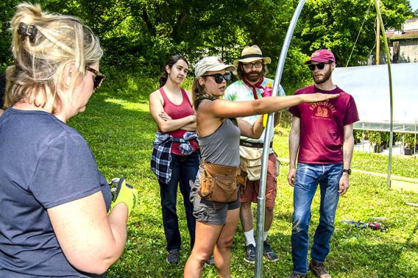 Studenets learn how to build a high tunnel at the Hindman Settlement School in Hindman, Kentucky.