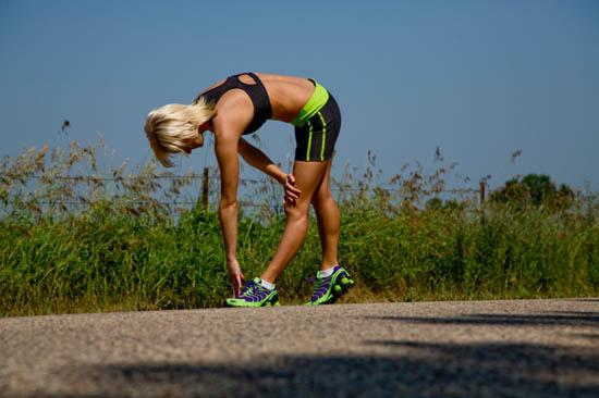 Woman stretching before run in the country