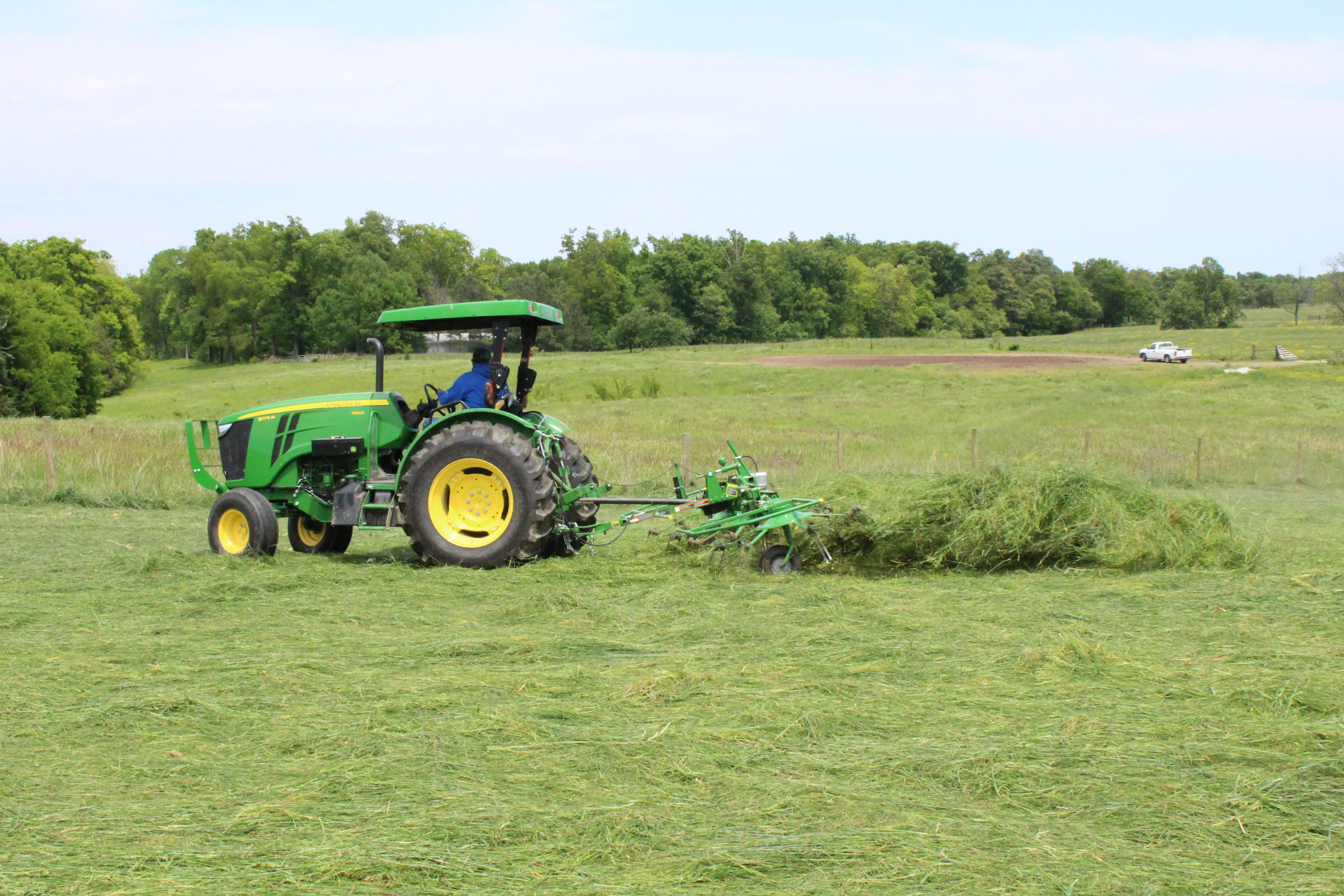 A producer cutting alfalfa hay. Photo courtesy of Chris Teutsch, UK forage extension specialist.
