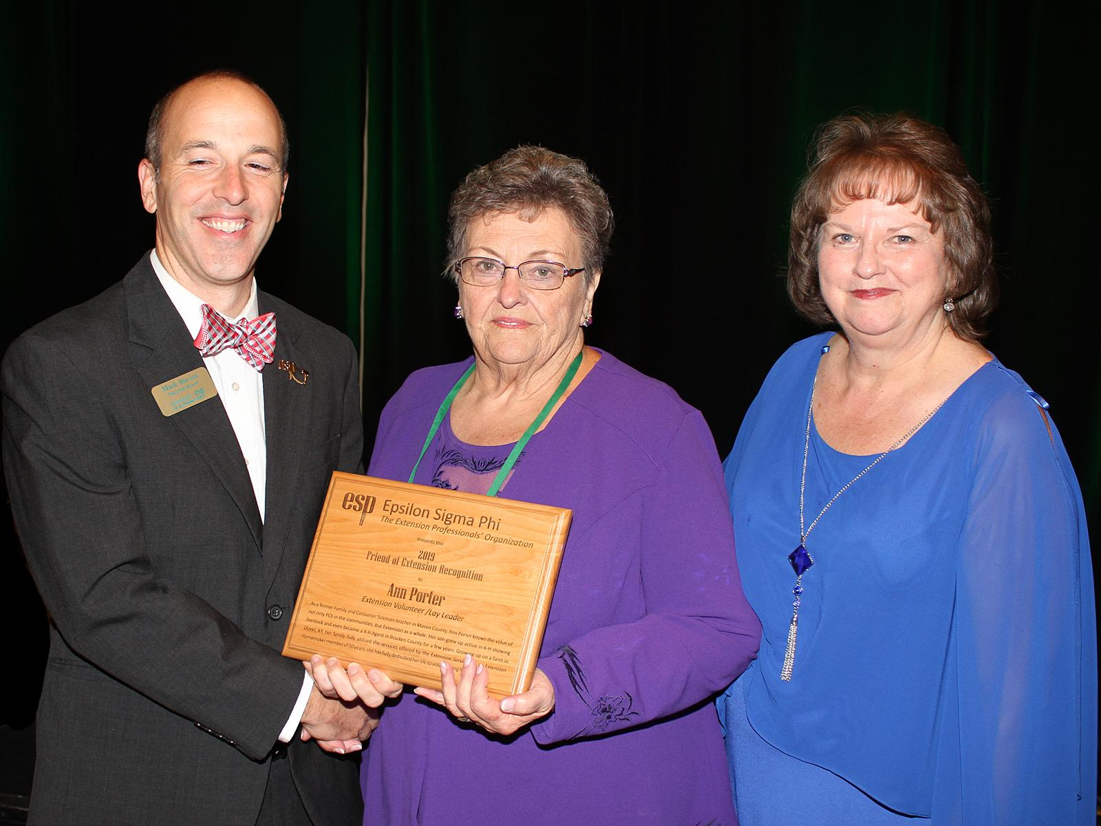 Ann Porter, center, accepts the 2019 Friend of Extension-Volunteer/Lay Leader Award from Mark Blevins, Epsilon Sigma Phi president. Also pictured is Nellie Buchanan, Morgan County family and consumer sciences extension agent. Photo by Billy Warrick.