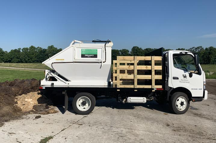 UK Recycling's truck that is outfitted with an enclosed, self-dumping container and cart tipper.